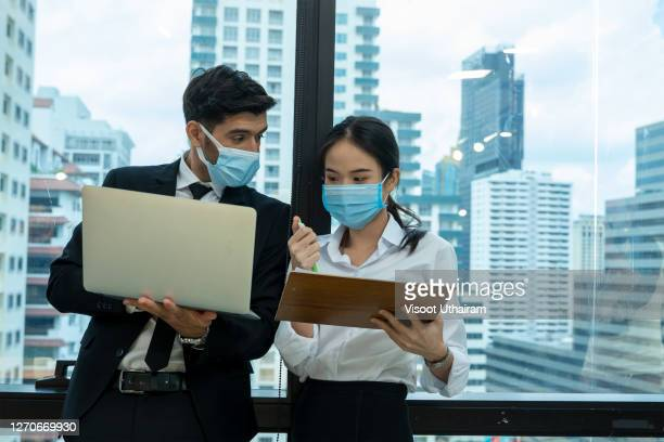 new normal business practices of corona virus covid-19 outbreak control. - employee engagement stock pictures, royalty-free photos & images