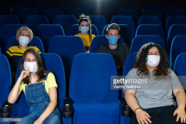 covid-19 new normal in cinema. audience in cinema. - film industry stock pictures, royalty-free photos & images