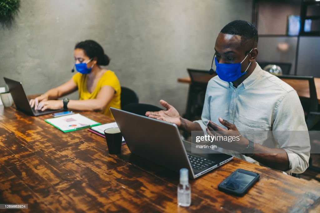 New normal in the office-social distancing : Stock Photo