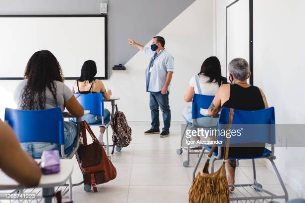 new normal: university class with social distancing - wide stock pictures, royalty-free photos & images