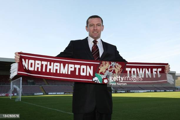 New Northampton Town manager Aidy Boothroyd poses with a scarf during a press conference to anncounce his appointment at Sixfields Stadium on...