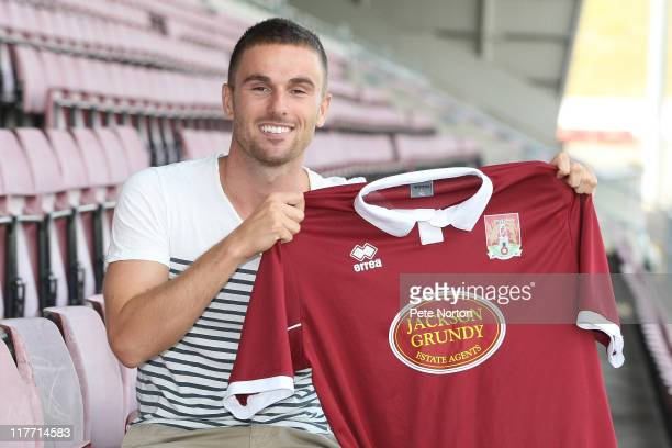 New Northampton Town signing Arron Davies poses with a shirt during a photo call on June 30 2011 in Northampton England