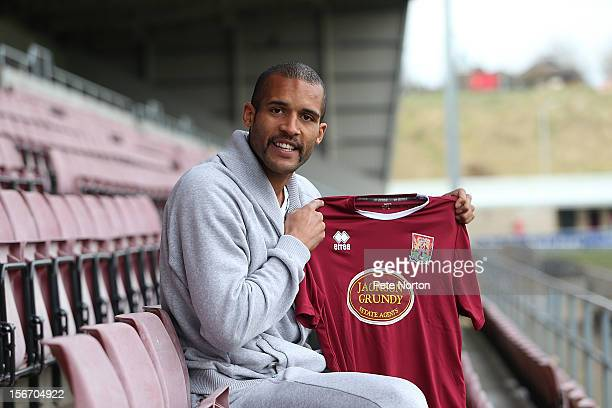 New Northampton Town signing Clarke Carlisle poses with a shirt during a press conference at Sixfields Staium on November 19 2012 in Northampton...