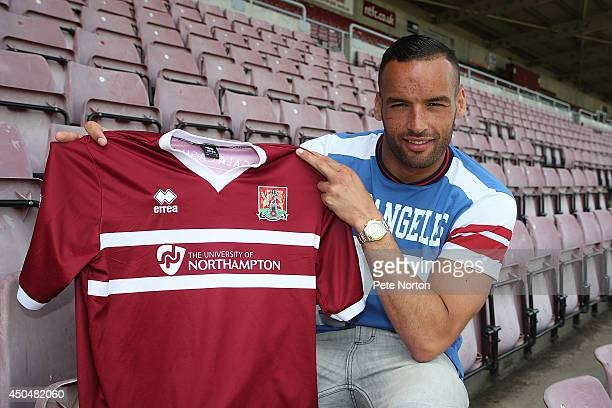 New Northampton Town signing Kaid Mohamed poses with a shirt during a photo call at Sixfields Stadium on June 12 2014 in Northampton England