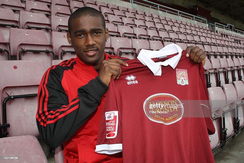 New Northampton Town signing Nathaniel Wedderburn holds a shirt during a press conference to announce his signing held at Sixfields Stadium on June 9, 2010 in Northampton, England.
