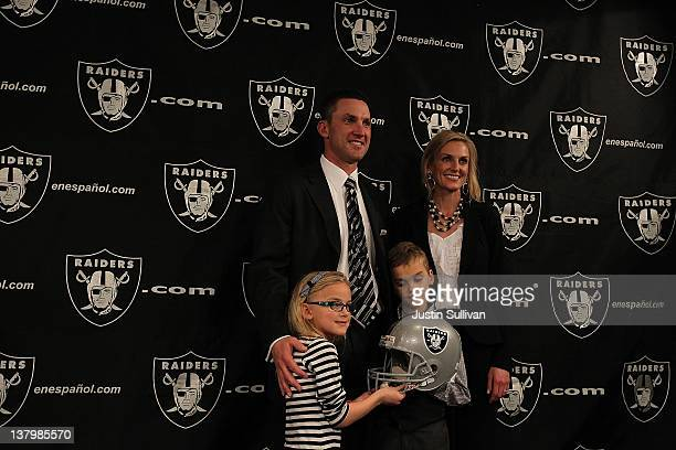 New Oakland Raiders head coach Dennis Allen poses for a photo with his wife Alisson daughter Layla and son Garrison during a press conference on...