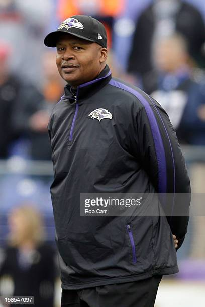 New offensive coordinator Jim Caldwell of the Baltimore Ravens watches the team warm up before the start of the Ravens game against the Denver...