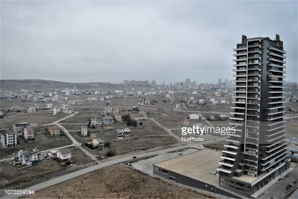 A new office tower is seen near old apartments in the upperclass neighborhood of Cayyolu some 25 kilometers outside the city center of Ankara Turkey...