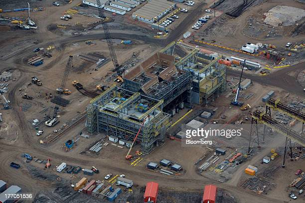 A new oil refining facility stands under construction at a Syncrude Canada Ltd mining site near Fort McMurray Alberta Canada on Tuesday Aug 13 2013...