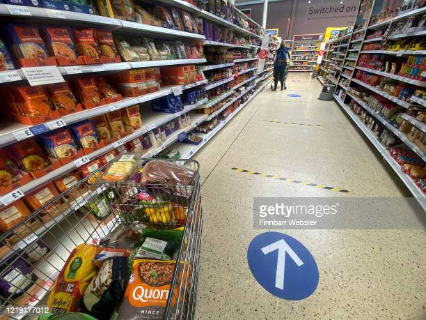 New one-way system seen in Tesco supermarket on April 16, 2020 in Portland, United Kingdom. Tesco has introduced new one-way system while browsing...