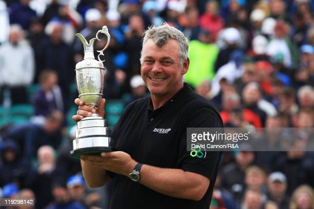 New Open Champion Darren Clarke of Northern Ireland poses with the Claret Jug following his victory during the final round of The 140th Open...