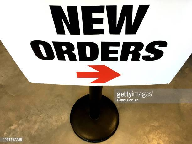 new orders sign with a red arrow - rafael ben ari stock-fotos und bilder