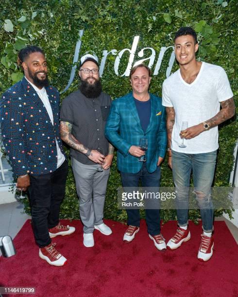 New Orlean Saints Cameron Jordan artist Troy Cole CEO Jordan Winery John Jordan and Los Angeles Laker Kyle Kuzma attend the 2015 Jordan Cabernet...