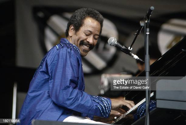 New Orleans based musician composer and producer Allen Toussaint performs at the New Orleans Jazz and Heritage Festival in April 1994 in New Orleans...