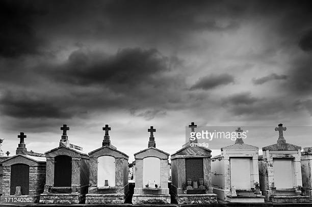 new orleans cemetery under a threatening sky - crypt stock photos and pictures