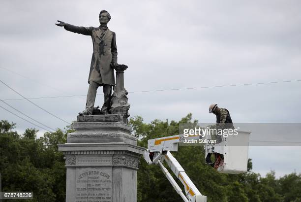 New Orleans city worker wearing body armor and a face covering as preapare to measure the Jefferson Davis monument on May 4 2017 in New Orleans...