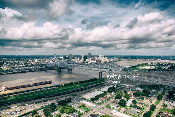 new orleans cityscape beyond the mississippi - la waterfront stock pictures, royalty-free photos & images