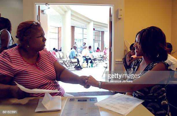 New Orleans evacuee Lynn Hayes thanks Dallas Housing Authority employee Dana Henley for helping her find an apartment September 6 2005 in Dallas...
