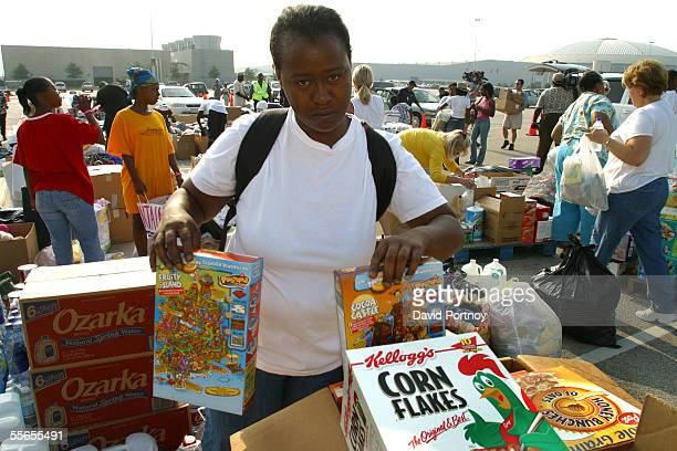New Orleans evacuee takes food donated by Texas residents outside the Astrodome in Houston Texas on September 1 2005