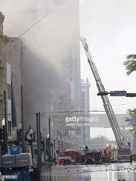 New Orleans Fire Department firefighters work a blaze despite the high flood waters 31 August 2005 at an athletic footware store that was looted in...