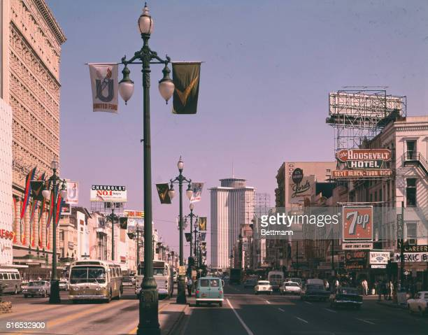 A street scene from the busy and crowded Canal Street in New Orleans