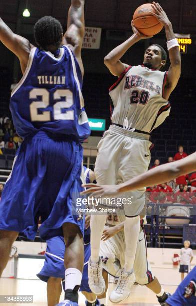 New Orleans guard Tim Tillman attempts to block Ole Miss guard Bam Doyne's shot at the Tad Smith Coliseum in Oxford, Mississippi on November 30,...