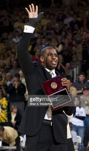 New Orleans Hornet and former Wake Forest point guard Chris Paul acknowledges the crowd after receiving the Arnold Palmer Award as the top Wake...
