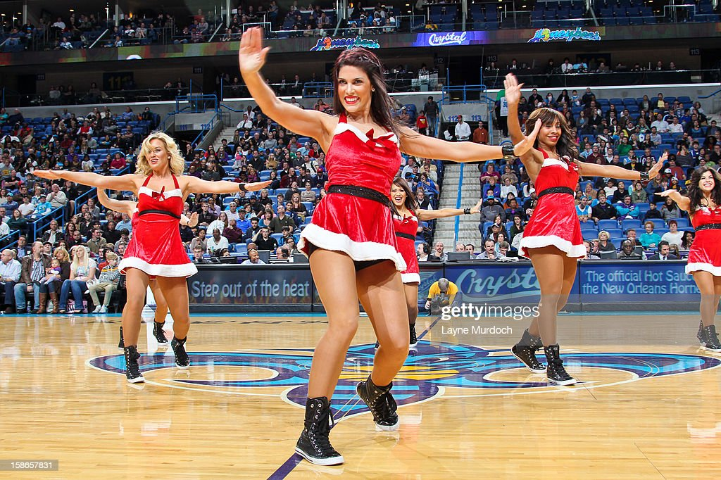 New Orleans Hornets dancers, wearing Christmas outfits, perform during a game against the Indiana Pacers on December 22, 2012 at the New Orleans Arena in New Orleans, Louisiana.