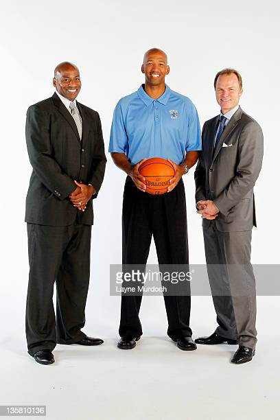 New Orleans Hornets General Manager Dell Demps Head Coach Monty Williams and President Hugh Weber pose for a portrait during 2011 NBA Media Day on...