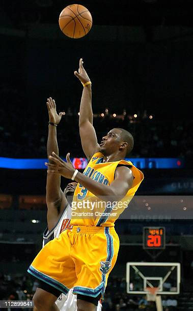 New Orleans Hornets guard Chris Paul releases a floater on a drive to the basket during second half action as Charlotte Bobcats Jeff McInnis applies...