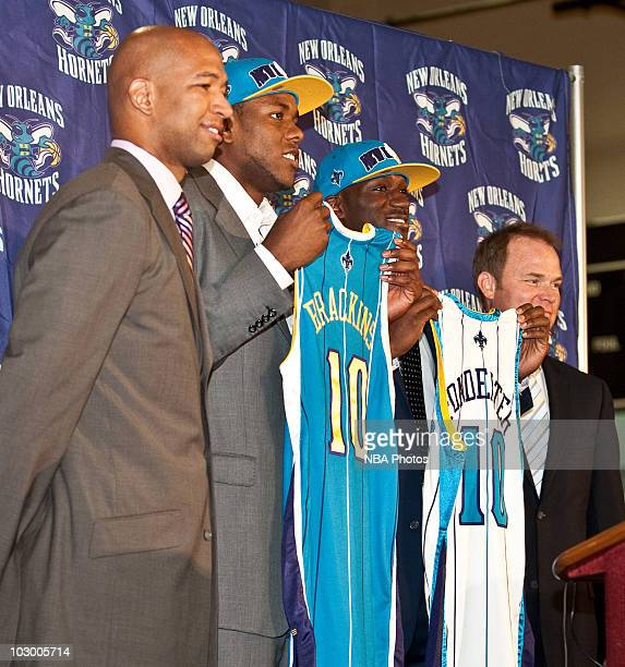 New Orleans Hornets Head Coach Monty Williams poses with 2010 draft picks Craig Brackins and Quincy Pondexter and President Hugh Weber on July 20...