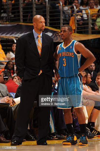 New Orleans Hornets head coach Monty Williams speaks to New Orleans Hornets point guard Chris Paul during the game against the Los Angeles Lakers in...