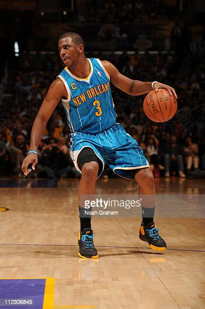 New Orleans Hornets point guard Chris Paul handles the ball during the game against the Los Angeles Lakers in Game One of the Western Conference...