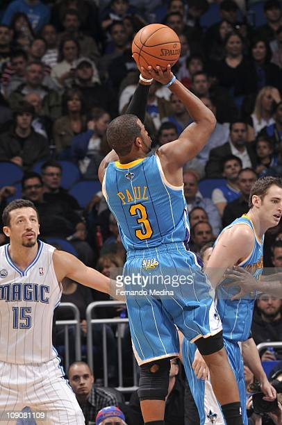New Orleans Hornets point guard Chris Paul looks to pass during the game against the Orlando Magic on February 11 2011 at the Amway Center in Orlando...