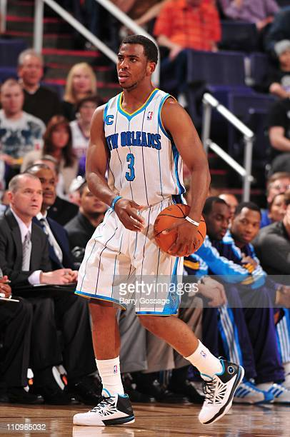 New Orleans Hornets point guard Chris Paul protects the ball during the game against the Phoenix Suns March 25 2011 at US Airways Center in Phoenix...
