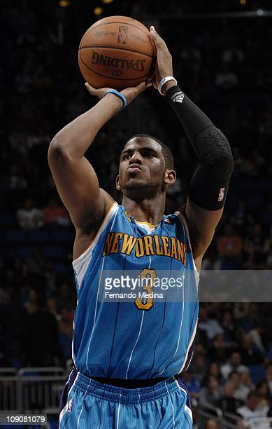 New Orleans Hornets point guard Chris Paul shoots a free throw during the game against the Orlando Magic on February 11 2011 at the Amway Center in...