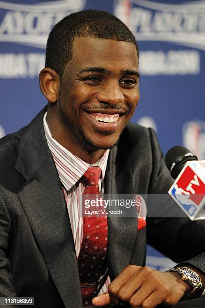 New Orleans Hornets point guard Chris Paul smiles during the conference after the game against the Los Angeles Lakers in Game Four of the Western...