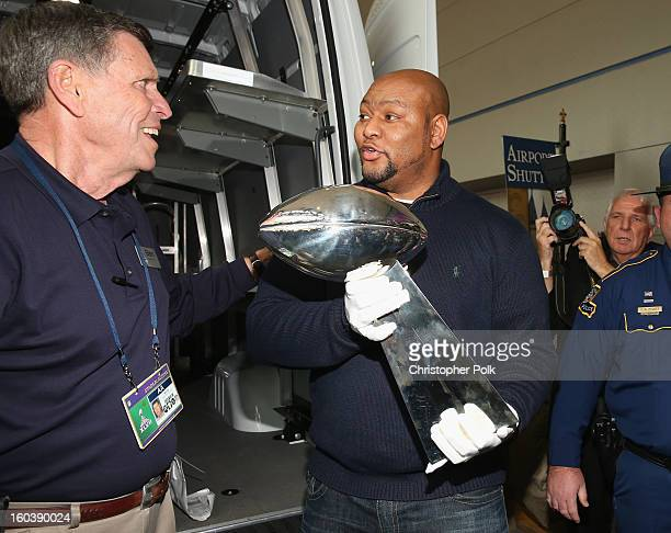 New Orleans LA Ben Nix of NFL Security hands the Vince Lombardi Trophy to NFL player Deuce McAllister As the Official Delivery Service Sponsor of the...