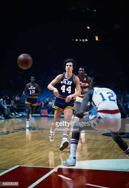 New Orleans Jazz's guard Pete Maravich passes near the basket during a game against the Washington Bullets at Capital Center circa the 1970's in...