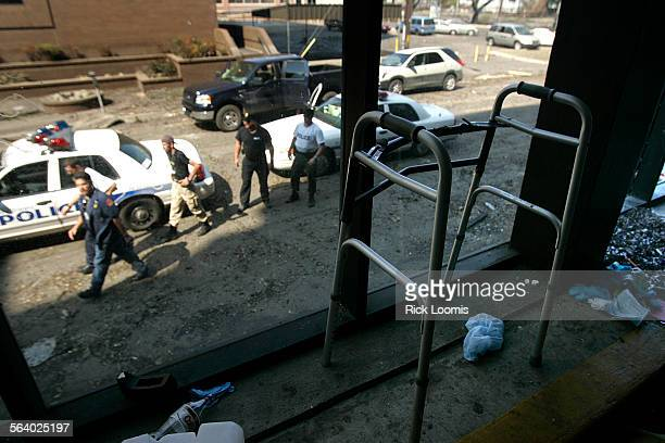 New Orleans La – A walker sits in the entryway to Memorial Medical Center in New Orleans where approximately 44 patients died in the aftermath of...