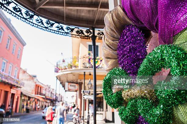 usa, new orleans, louisiana, fleur de lys and street in background - new orleans mardi gras stock photos and pictures