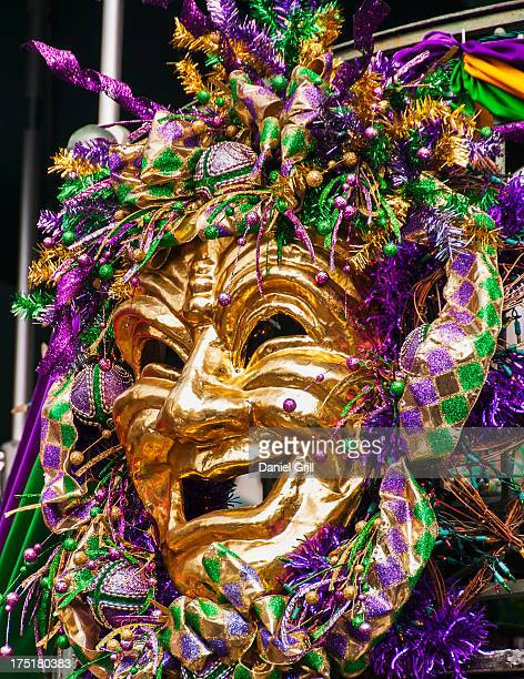 usa, new orleans, louisiana, mardi gras mask hanging on balcony's railing - new orleans mardi gras stock photos and pictures
