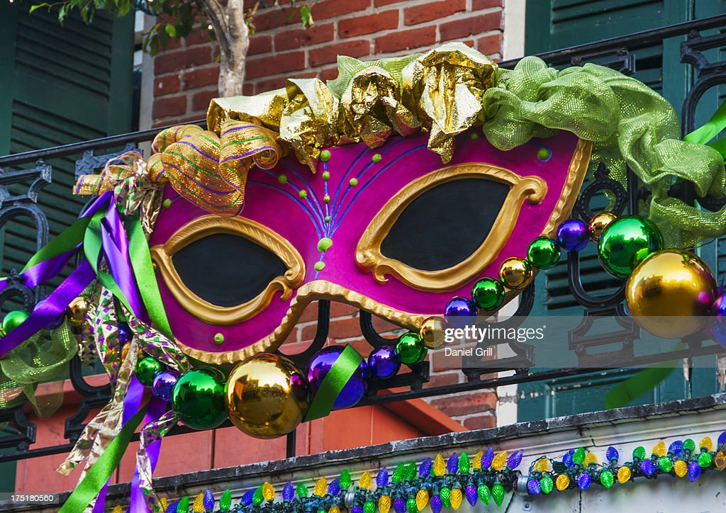 USA, New Orleans, Louisiana, Mardi Gras mask hanging on balcony's railing : Foto de stock
