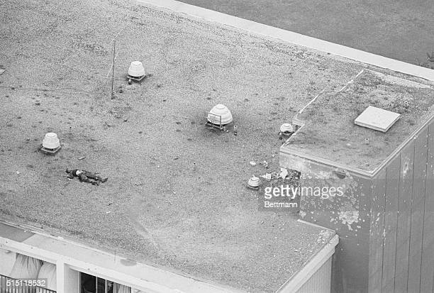 New Orleans Louisiana The bullet riddled body of a sniper felled by helicopter gunfire lies atop the Howard Johnson Motor Lodge the scene of a battle...
