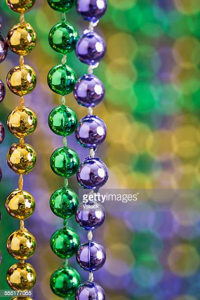 new orleans mardi gras decoration - mardi gras beads stock photos and pictures