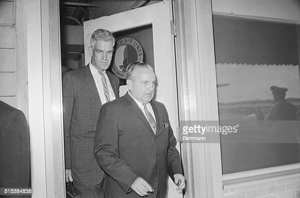New Orlean's mob boss Carlos Marcello being escorted by an unidentified US Immigration official to the airport to be flown to the illegal alien camp...