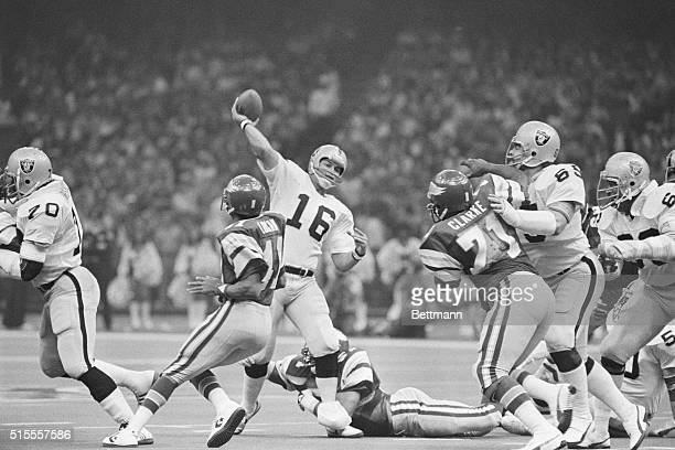 New Orleans: Oaklands' Jim Plunkett flips a short pass downfield, incomplete, as the Eagles' Randy Logan and Ken Clarke put pressure on him during...
