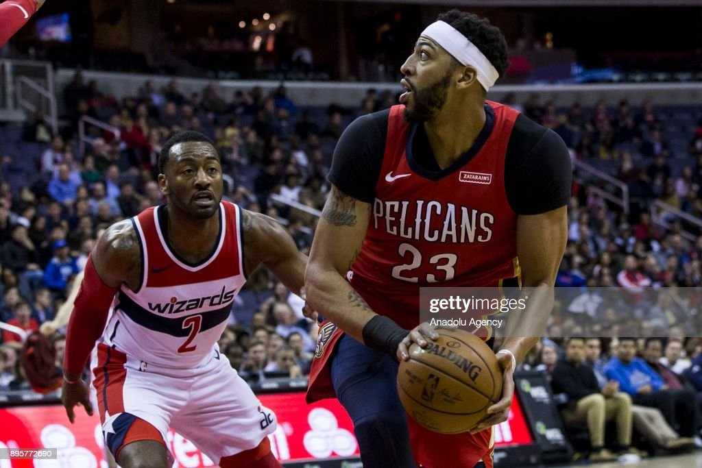 New Orleans Pelicans' Anthony Davis (23) tries to keep the ball away from Washington Wizards' John Wall (2) during the NBA match between Washington Wizards and New Orleans Pelicans at the Capital One Arena in Washington, United States on December 19, 2017.