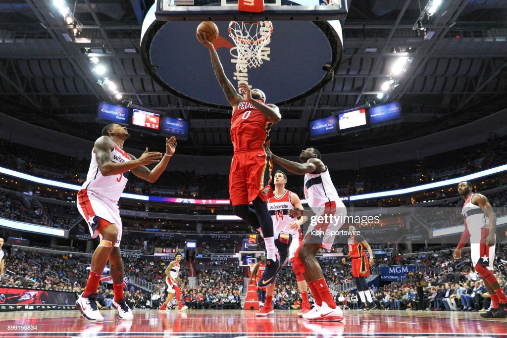 New Orleans Pelicans center DeMarcus Cousins (0) scores on a second half dunk against Washington Wizards center Ian Mahinmi (28) and guard Bradley Beal (3) on December 19, 2017 at the Capital One Arena in Washington, D.C. The Washington Wizards defeated the New Orleans Pelicans, 116-106.