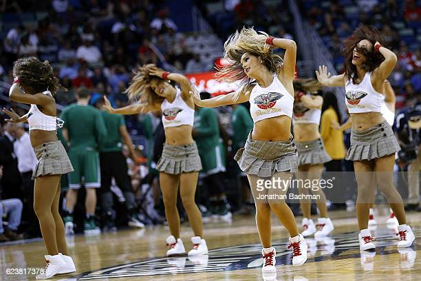 New Orleans Pelicans cheerleader performs during a game against the Boston Celtics at the Smoothie King Center on November 14 2016 in New Orleans...